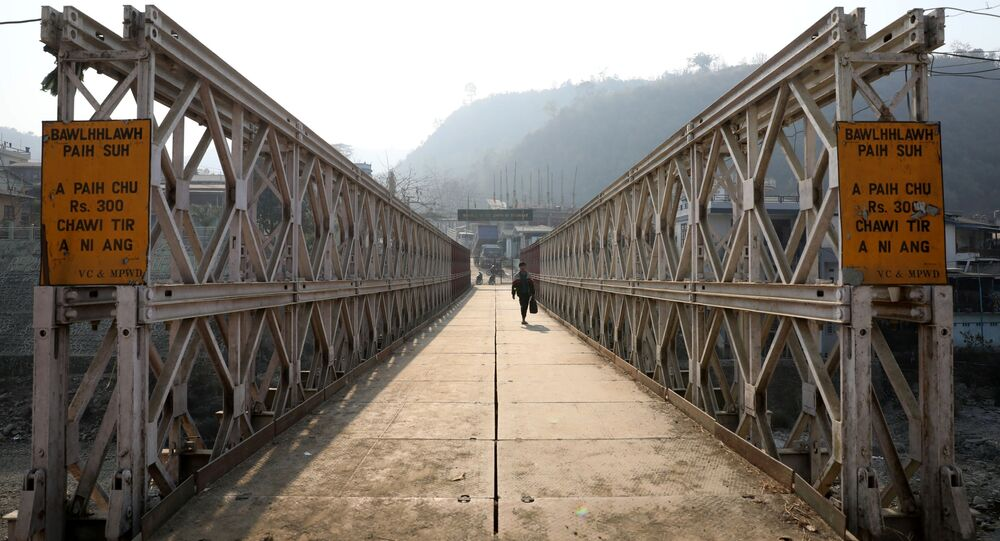 A person walks on a bridge that connects Myanmar and India at the border village of Zokhawthar,  Champhai district, in India's northeastern state of Mizoram, India, March 12, 2021