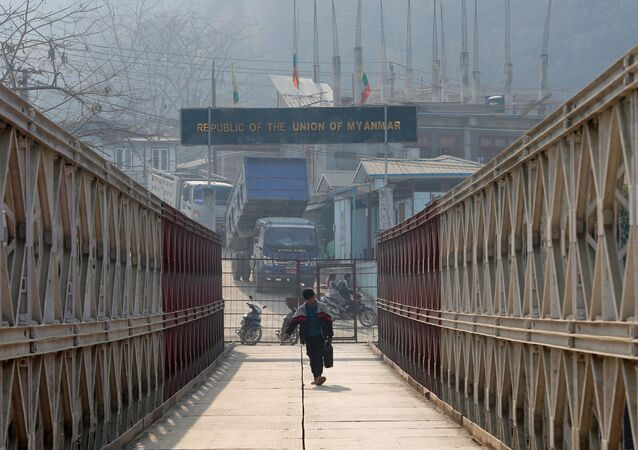A man walks on a bridge that connects Myanmar and India at the border village of Zokhawthar, Champhai district, in India's northeastern state of Mizoram, India, March 12, 2021