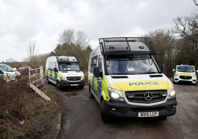 Police vehicles are seen at the Great Chart Golf & Leisure Country Club, as the investigation into the disappearance of Sarah Everard continues, in Ashford, Britain, March 11, 2021