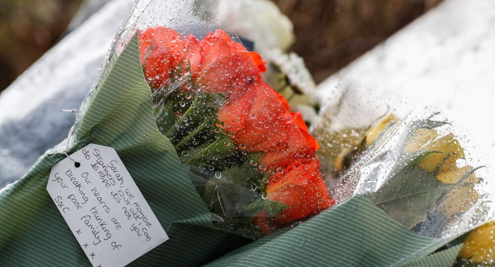 Flowers placed by police officers at the golf course entrance are pictured, as the investigation into the disappearance of Sarah Everard continues, in Ashford, Britain, March 11, 2021