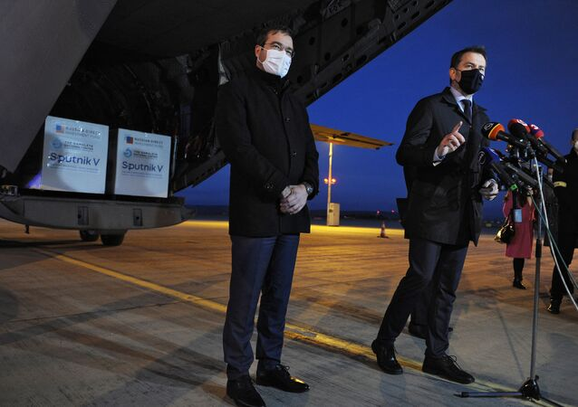 Slovak Prime Minister Igor Matovic (R) and Slovak Health Minister Marek Krajci give a press statement at the International Airport in Kosice, Slovakia, on March 1, 2021, after an aircraft of the Slovak Army arrived from Moscow, carrying doses of the Sputnik V vaccine against the coronavirus (Covid-19).