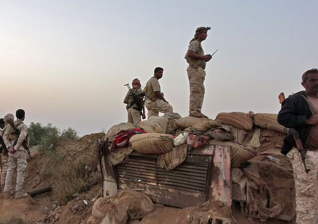 Forces loyal to Yemen's Saudi-backed government enter the Abs district of the northwestern Hajjah province on March 11, 2021.