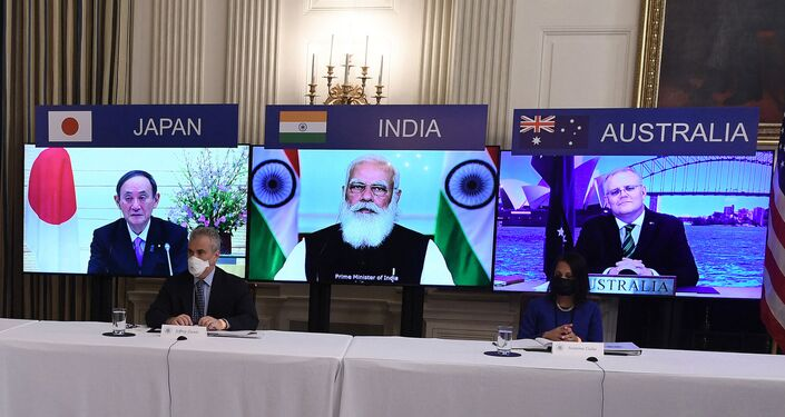 (On screens, L-R) Japanese Prime Minister Yoshihide Suga, Indian Prime Minister Narendra Modi and Australian Prime Minister Scott Morrison listen during a virtual meeting of the Quad alliance members: Australia, India, Japan and the US, in the State Dining Room of the White House in Washington, DC, on March 12, 2021.
