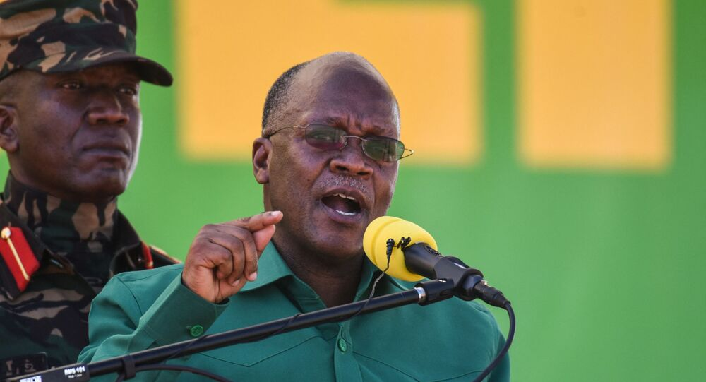 In this file photo taken on August 29, 2020 Tanzania's incumbent President and presidential candidate of ruling party Chama Cha Mapinduzi (CCM) John Magufuli (R) speaks during the official launch of the party's campaign for the October general election at the Jamhuri stadium in Dodoma, Tanzania