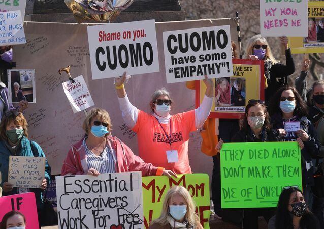 Protestors gather outside the New York State Capitol, following allegations that New York Governor Andrew Cuomo had sexually harassed young women, in Albany, New York, U.S., March 12, 2021