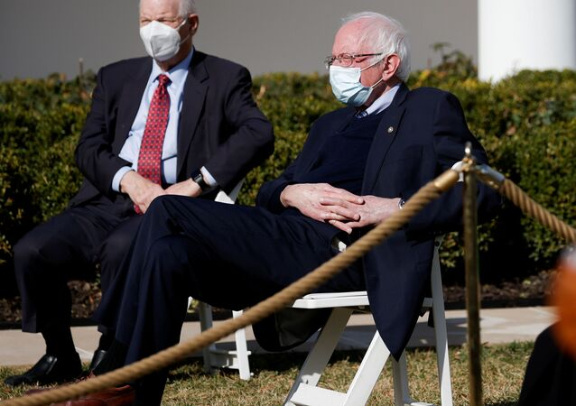 U.S. Senator Bernie Sanders (I-VT) listens with other guests as President Joe Biden speaks about the $1.9 trillion American Rescue Plan Act  during an event to celebrate the legislation in the Rose Garden at the White House in Washington, U.S., March 12, 2021.