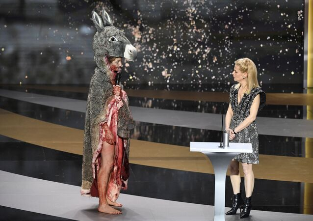 French actress Corinne Masiero (L) delivers a speech wearing a Peau d'Ane costume next to French actress and Master of Ceremony Marina Fois during the 46th edition of the Cesar Film Awards ceremony at The Olympia concert venue in Paris on 12 March 2021