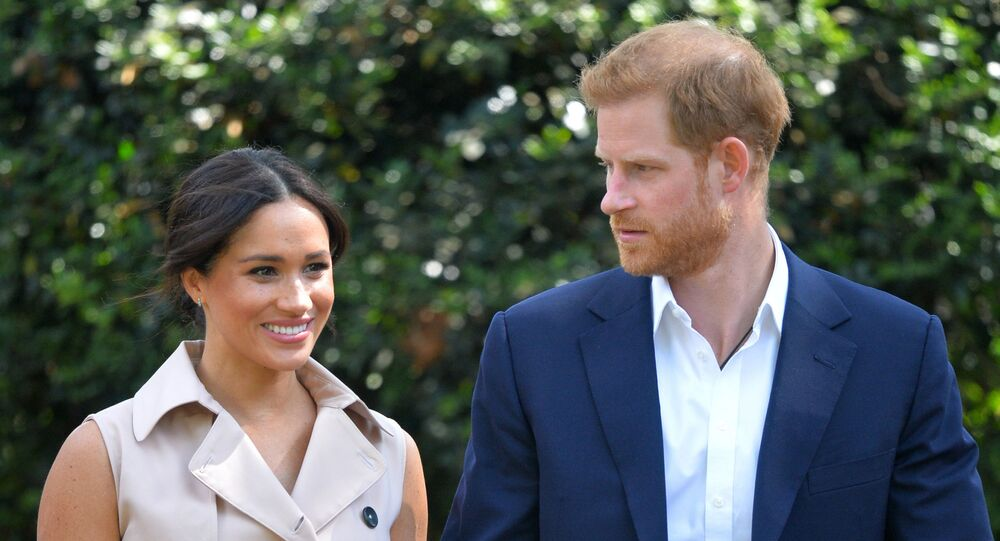 In this 2 October 2019, file photo, Britain's Prince Harry and Meghan, Duchess of Sussex arrive at the Creative Industries and Business Reception at the British High Commissioner's residence in Johannesburg, where they will meet with representatives of the British and South African business communities, including local youth entrepreneurs