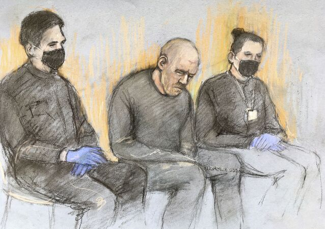 This court artist sketch by Elizabeth Cook shows serving police constable Wayne Couzens, center appearing in the dock at Westminster Magistrates' Court, in London, Saturday, March 13, 2021