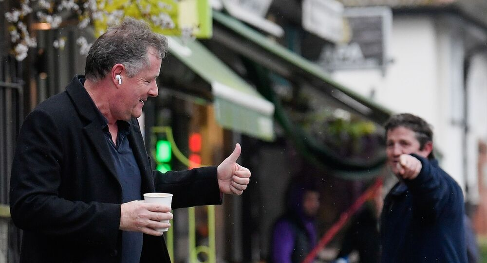 Journalist and television presenter Piers Morgan gestures back to a passerby as he walks near his house, after he left his high-profile breakfast slot with the broadcaster ITV, following his long-running criticism of Prince Harry's wife Meghan, in London, Britain, March 10, 2021