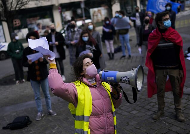 Students shout slogans during a protest against the isolation and precariousness due to the COVID-19 partial lockdown restrictions in Brussels, Thursday, March 11, 2021. Protesters demanded the full reopening of classes, the resumption of extra-curricular activities, psychological support and other things in a country where universities and schools are still not open full time or are offering much of their education through online platforms. (AP Photo/Francisco Seco)