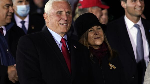 Vice President Mike Pence and his wife Karen listen as President Donald Trump speaks during a campaign rally at Gerald R. Ford International Airport, early Tuesday, Nov. 3, 2020, in Grand Rapids, Mich. - Sputnik International