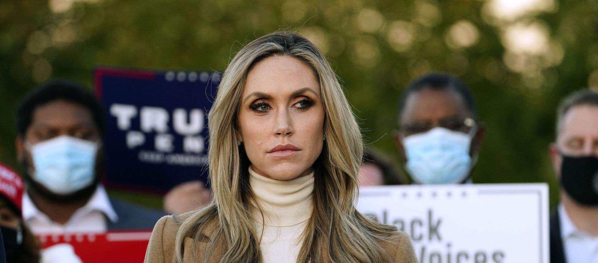 Lara Trump, daughter-in-law of President Donald Trump listens to Rudy Giuliani, a lawyer for President Trump, speak during a news conference on legal challenges to vote counting in Pennsylvania, Wednesday, Nov. 4, 2020, in Philadelphia - Sputnik International, 1920, 10.04.2021