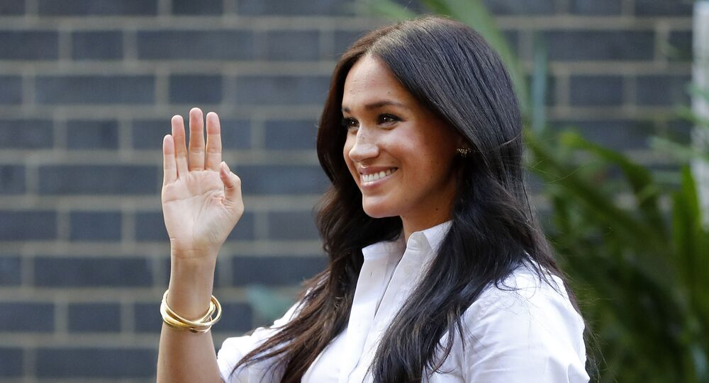 Meghan, Duchess of Sussex, waves as she leaves a department store after launching the Smart Set Capsule Collection by UK charity Smart Works, in London, Thursday, 12 September 2019.