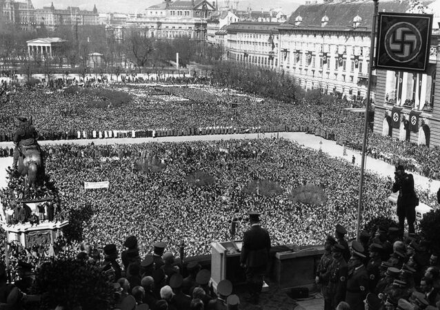 A general view of German Chancellor Adolf Hitler, centre bottom back to camera, addressing the huge crowd in the Heldenplatz in Vienna, Austria, on March 15, 1938, illustrating the depth of the people who stood for hours to welcome Hitler officially to Vienna and Austria.