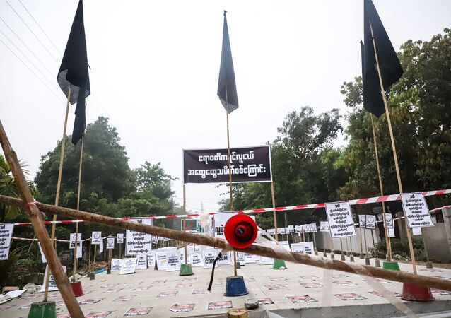 View of a loudspeaker and signs during a protest without demonstrators present in Nyaungdon, Ayeyarwady, Myanmar