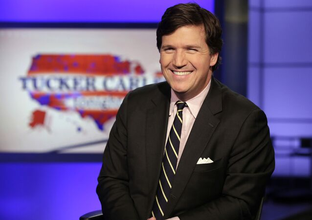 Tucker Carlson, host of Tucker Carlson Tonight, poses for photos in a Fox News Channel studio, in New York, Thursday, March 2, 2017