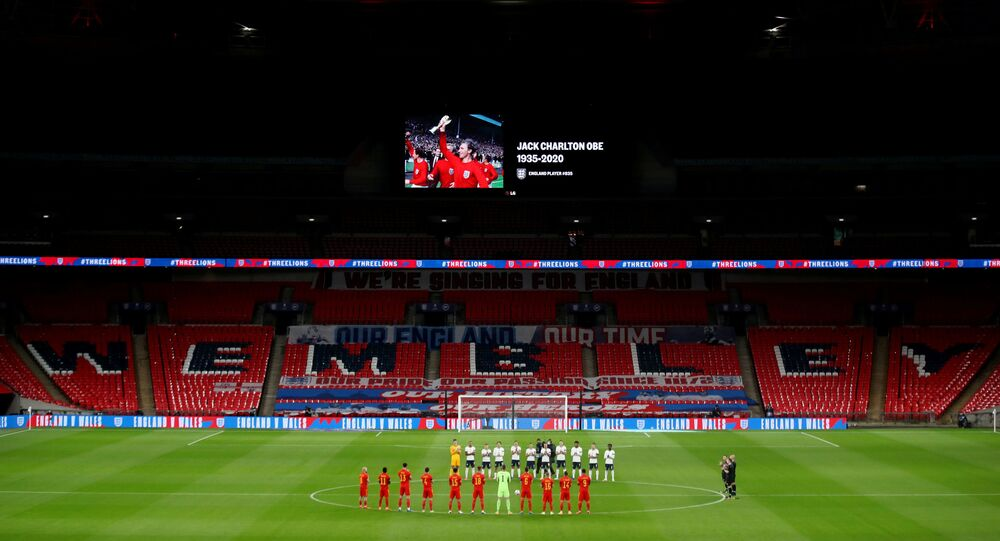 England and Wales football players hold a minutes applause for the late World Cup winner Jack Charlton who passed away, as a mark of respect during an International Friendly football match between England and Wales at Wembley Stadium, during the coronavirus disease (COVID-19) outbreak, in London, Britain, October 8, 2020