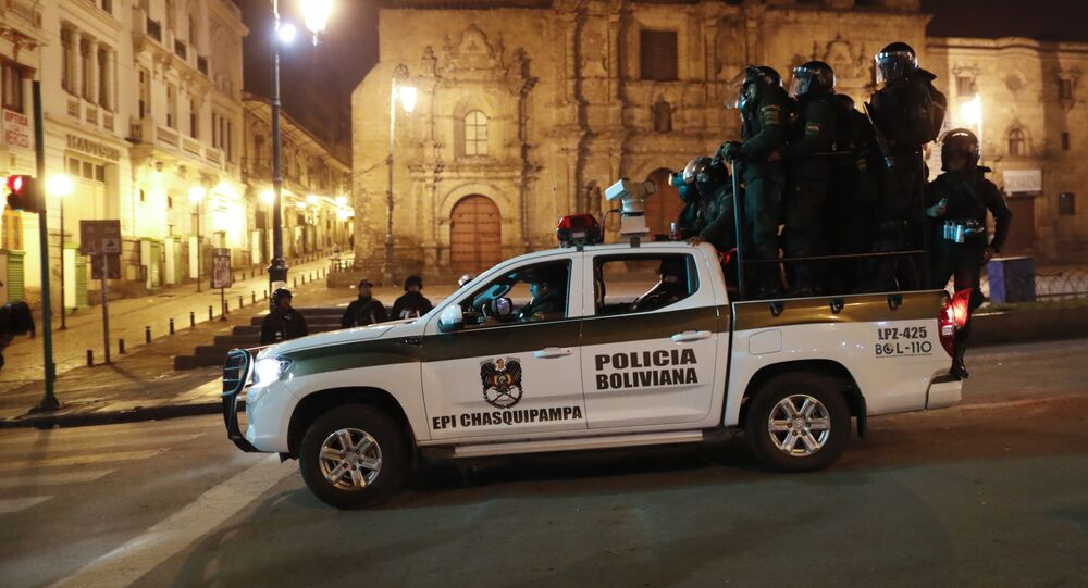 Police patrol in La Paz, Bolivia, Monday, Nov. 11, 2019. Former Bolivian President Evo Morales said Monday he was headed for Mexico after being granted asylum there, as his supporters and foes clashed on the streets of the capital following his resignation.
