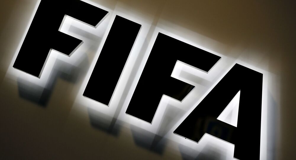 The FIFA logo outside FIFA headquarters in Zurich, Switzerland, Friday, Sept. 25, 2015.
