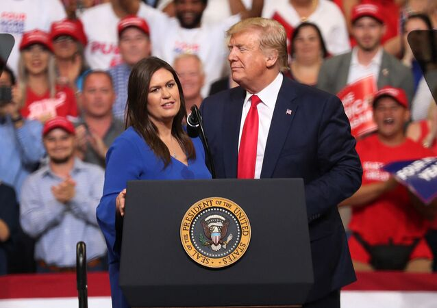 JUNE 18: U.S. President Donald Trump stands with Sarah Huckabee Sanders, who announced that she is stepping down as the White House press secretary, during his rally where he announced his candidacy for a second presidential term at the Amway Center on June 18, 2019 in Orlando, Florida