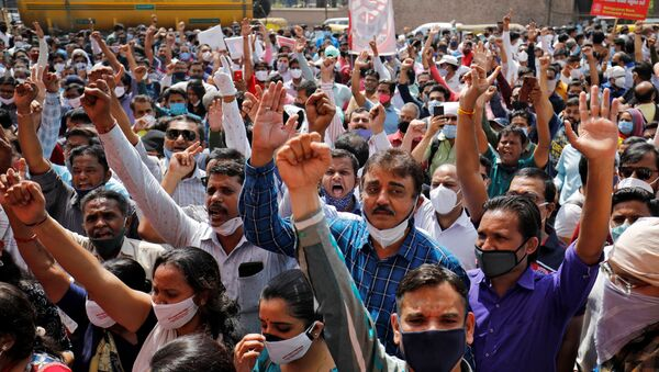 Bank employees shout slogans during a protest, as part of a two-day long nationwide strike, outside a bank in Ahmedabad, India, March 15, 2021 - Sputnik International