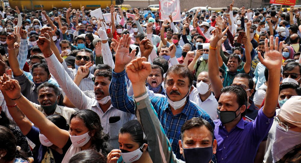 Bank employees shout slogans during a protest, as part of a two-day long nationwide strike, outside a bank in Ahmedabad, India, March 15, 2021