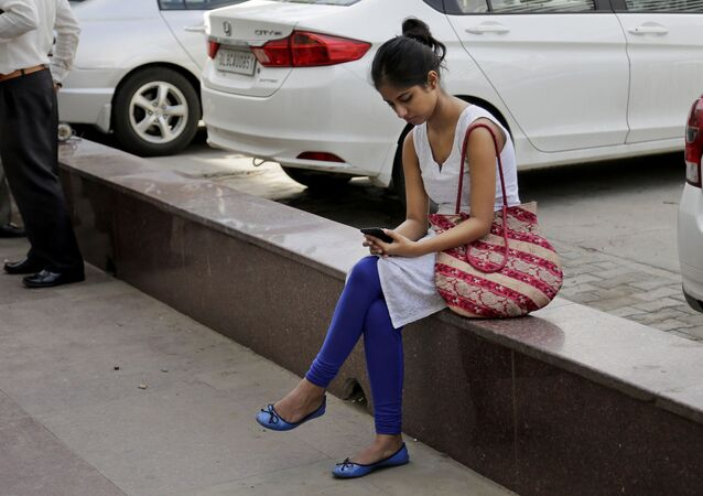 An Indian woman uses her mobile phone  in New Delhi, India on Tuesday 22 September 2015.
