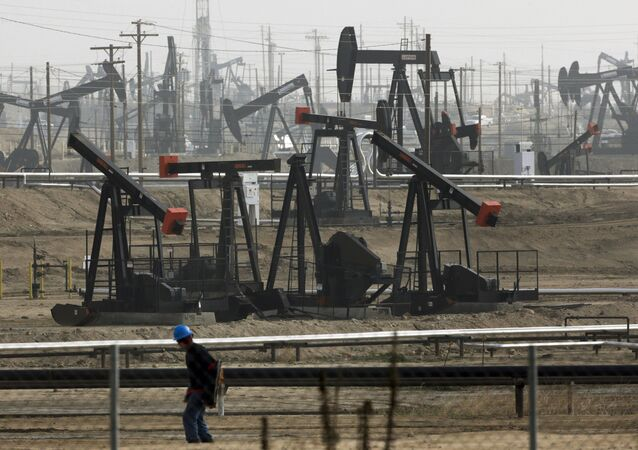 FILE - This Jan. 16, 2015, file photo shows pumpjacks operating at the Kern River Oil Field, in Bakersfield, Calif.