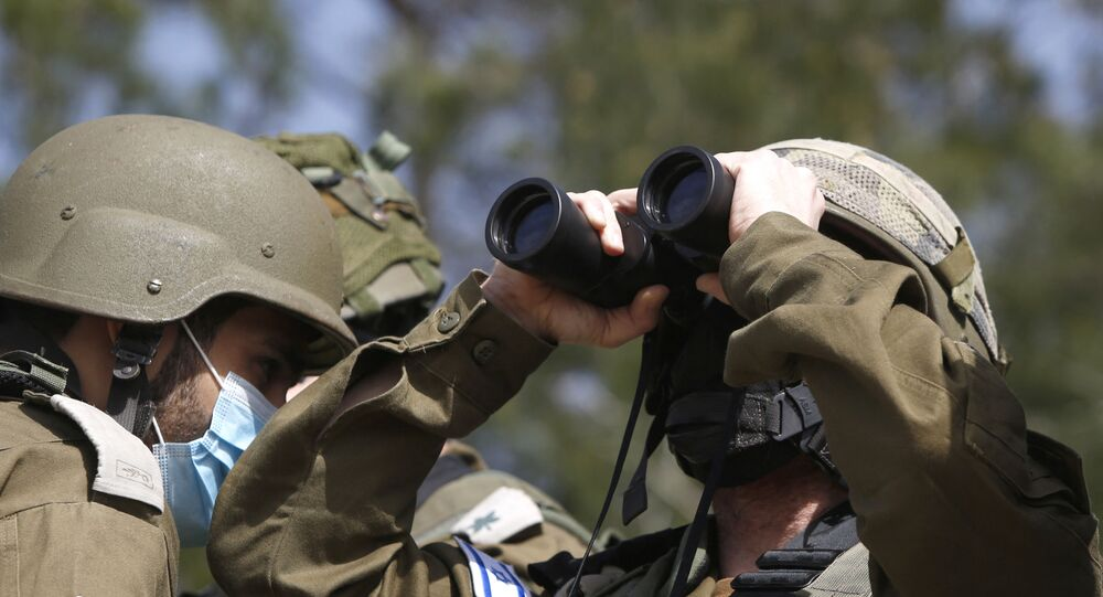 This picture taken on 9 March 2021, near the northern Israeli kibbutz of Misgav Am, shows Israeli forces watching the blue line, a demarcation line drawn by the United Nations to mark Israel's withdrawal from southern Lebanon in 2000.