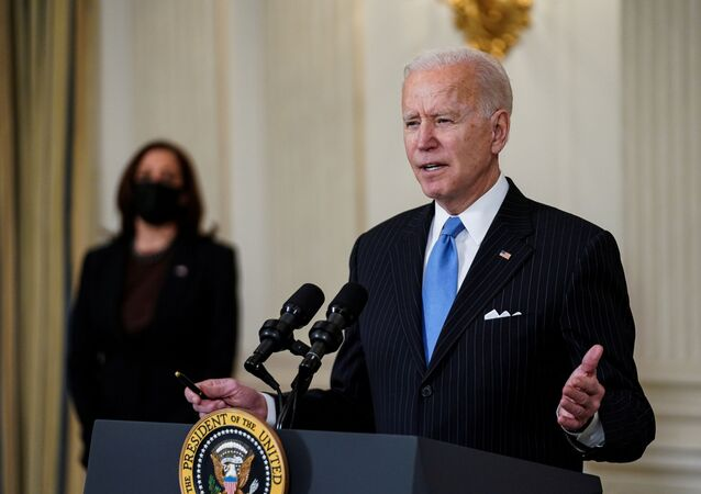 U.S. President Joe Biden speaks about the Biden administration's coronavirus disease (COVID-19) pandemic response as Vice President Kamala Harris listens in the State Dining Room at the White House in Washington, U.S., March 2, 2021. REUTERS/Kevin Lamarque