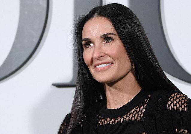 US actress Demi Moore poses during the photocall prior to the Dior Women's Fall-Winter 2020-2021 Ready-to-Wear collection fashion show in Paris, on February 25, 2020.
