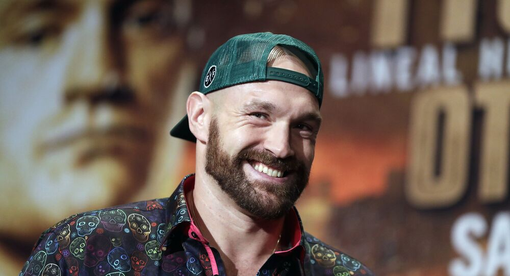 In a Sept. 11, 2019 file photo, Tyson Fury smiles during a press conference in Las Vegas.