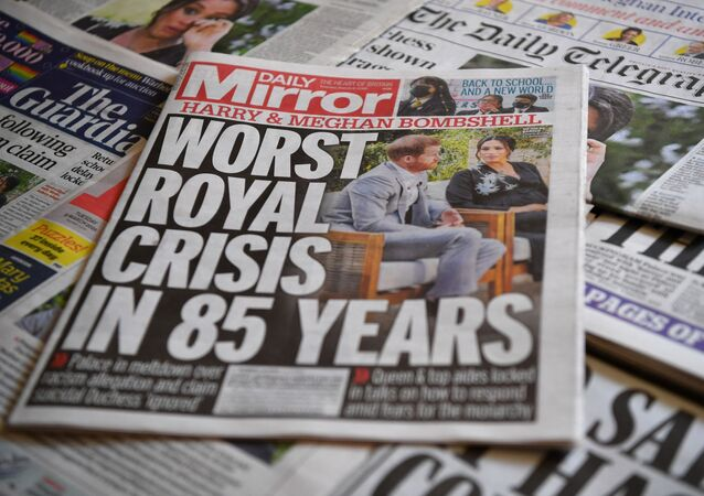 An arrangement of UK daily newspapers photographed as an illustration in Brenchley, Kent on March 9, 2021, shows front page headlines reporting on the story of the interview given by Meghan, Duchess of Sussex, wife of Britain's Prince Harry, Duke of Sussex, to Oprah Winfrey, which aired on UK broadcaster ITV.