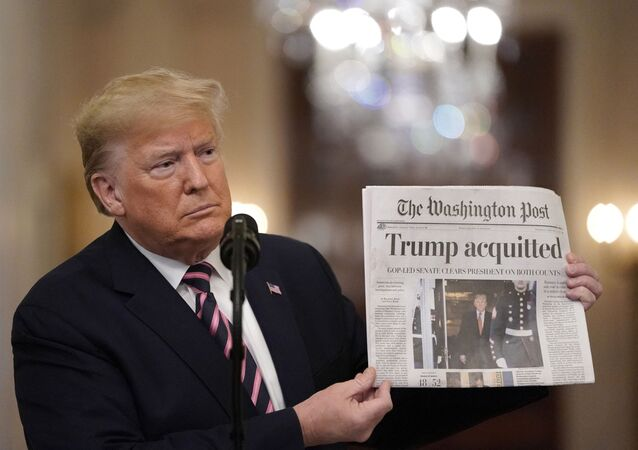 WASHINGTON, DC - FEBRUARY 06: U.S. President Donald Trump holds a copy of The Washington Post as he speaks in the East Room of the White House one day after the U.S. Senate acquitted on two articles of impeachment, ion February 6, 2020 in Washington, DC