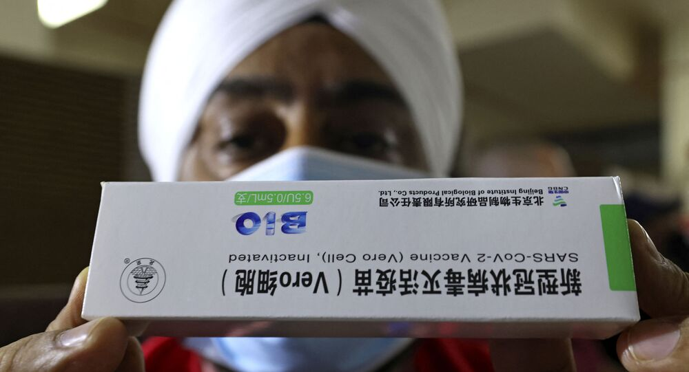 A Sikh healthcare worker holds a box of China's Sinopharm COVID-19 vaccine (File)