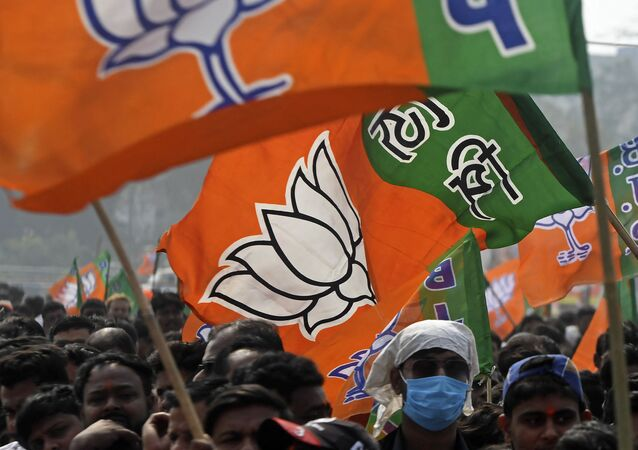 Activists of Bharatiya Janata Party (BJP) wave party flags during a public meeting being attended by the newly joined leaders along with party's national leaders in Howrah on the outskirts of Kolkata on January 31, 2021.