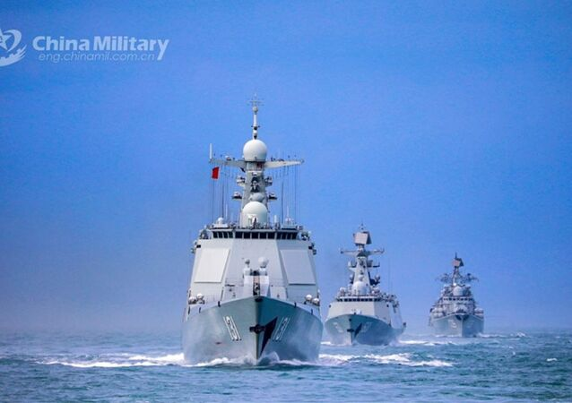 A naval fleet comprised of the guided-missile destroyers Ningbo (Hull 139) and Taiyuan (Hull 131), as well as the guided-missile frigate Nantong (Hull 601), steams in astern formation in waters of the East China Sea during a maritime training drill in late January, 2021