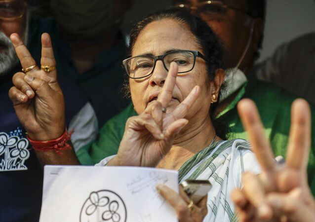 Chief Minister of West Bengal state and Trinamool Congress party leader Mamata Banerjee displays the victory symbol during the declaration of the names of the party's candidates for the upcoming legislative assembly elections in Kolkata, India, Friday, March 5, 2021.