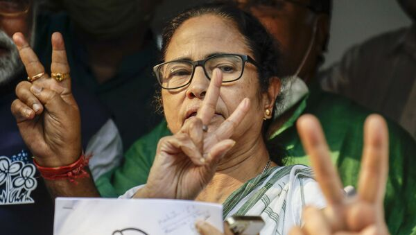Chief Minister of West Bengal state and Trinamool Congress party leader Mamata Banerjee displays the victory symbol during the declaration of the names of the party's candidates for the upcoming legislative assembly elections in Kolkata, India, Friday, March 5, 2021.  - Sputnik International