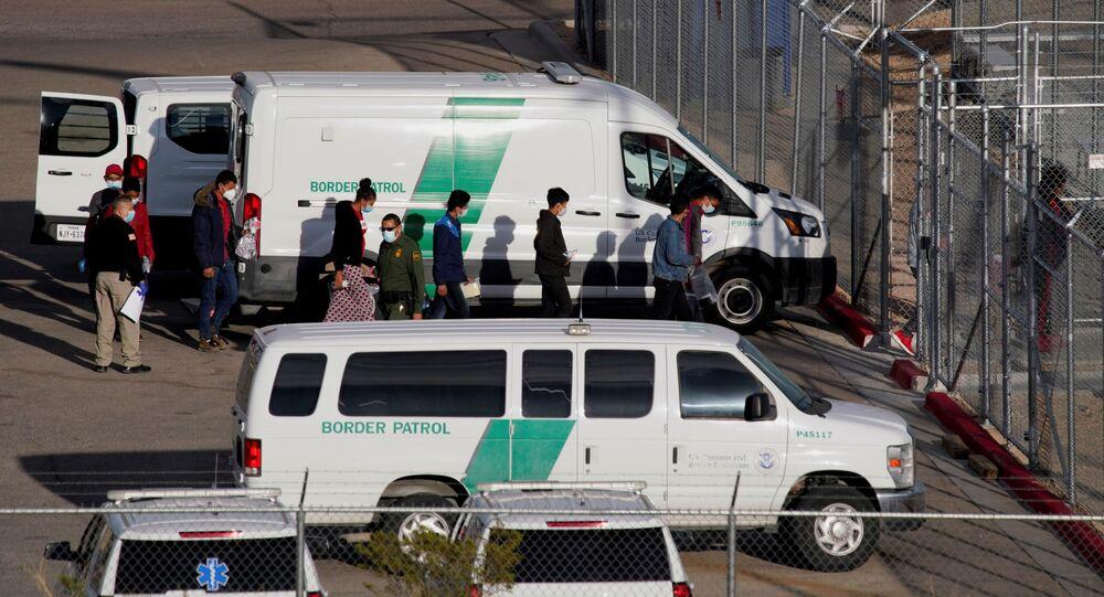 Migrants in United States Border Patrol custody file into a Border Patrol Station in El Paso, Texas, U.S. March 15, 2021