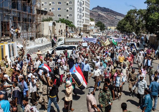 Protesters, some raising the old flag of South Yemen, gather to demonstrate against deteriorating services and economic conditions, outside the internationally-recognised Yemeni government's headquarters at al-Maashiq Palace in the Crater district of the southern port city of Aden on March 16, 2021