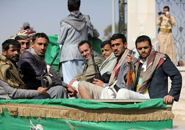 Armed Houthi followers ride on the back of a truck after participating in a funeral of Houthi fighters killed in recent fighting against government forces in Yemen's oil-rich province of Marib, in Sanaa, Yemen February 20, 2021.