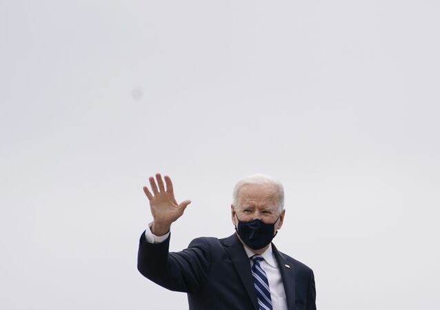 President Joe Biden waves before boarding Air Force One at Andrews Air Force Base, Md., Tuesday, March 16, 2021, en route to Philadelphia International Airport in Philadelphia.