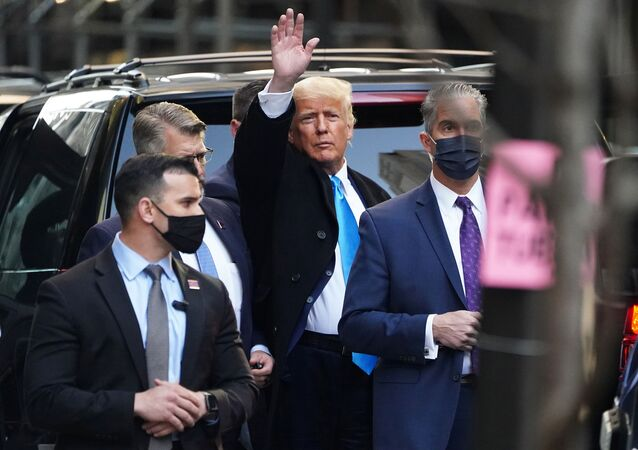 Former U.S. President Donald Trump acknowledges people as he gets in his SUV outside Trump Tower in the Manhattan borough of New York City, New York, U.S., March 9, 2021