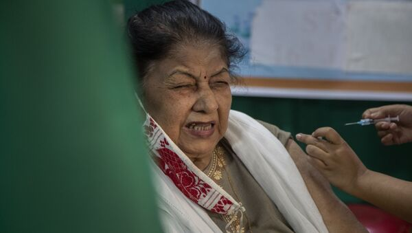 An elderly woman receives the COVID-19 vaccine at a private hospital in Gauhati, India, Thursday, March 4, 2021 - Sputnik International