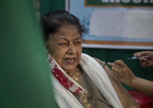 An elderly woman receives the COVID-19 vaccine at a private hospital in Gauhati, India, Thursday, March 4, 2021