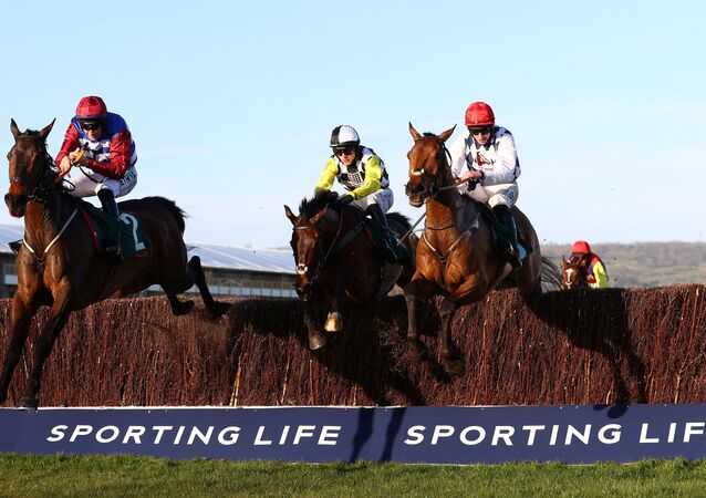 Horse Racing - Cheltenham Festival - Cheltenham Racecourse, Cheltenham, Britain - March 16, 2021  Jack Kennedy riding Galvin (R) wins the 4.50 Sam Vestey National Hunt Challenge Cup Novices' Chase