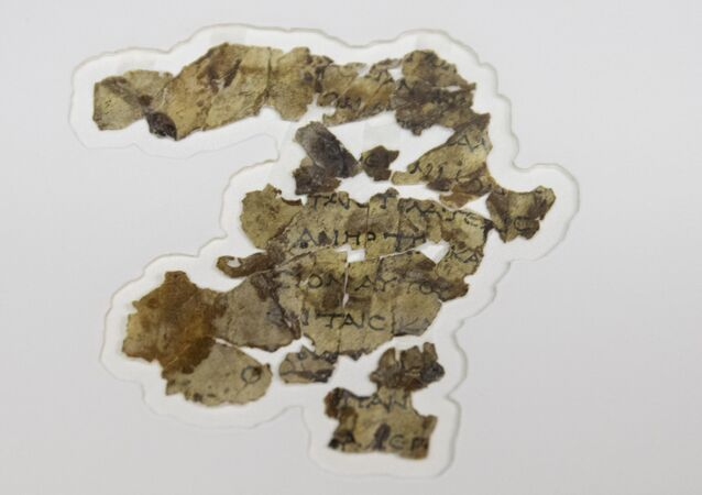 The Israel Antiquities Authority displays newly discovered Dead Sea Scroll fragments at the Dead Sea scrolls conservation lab in Jerusalem, Tuesday, March 16, 2021
