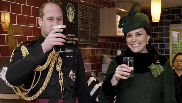 Britain's Kate, the Duchess of Cambridge, smiles as she and Prince William toast, as they visit the 1st Battalion Irish Guards, for the St. Patrick's Day Parade, at Cavalry Barracks, in Hounslow, England, Saturday, March 17, 2018.   - Sputnik International